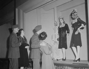 Soldiers and their girls window shopping. April, 1943.